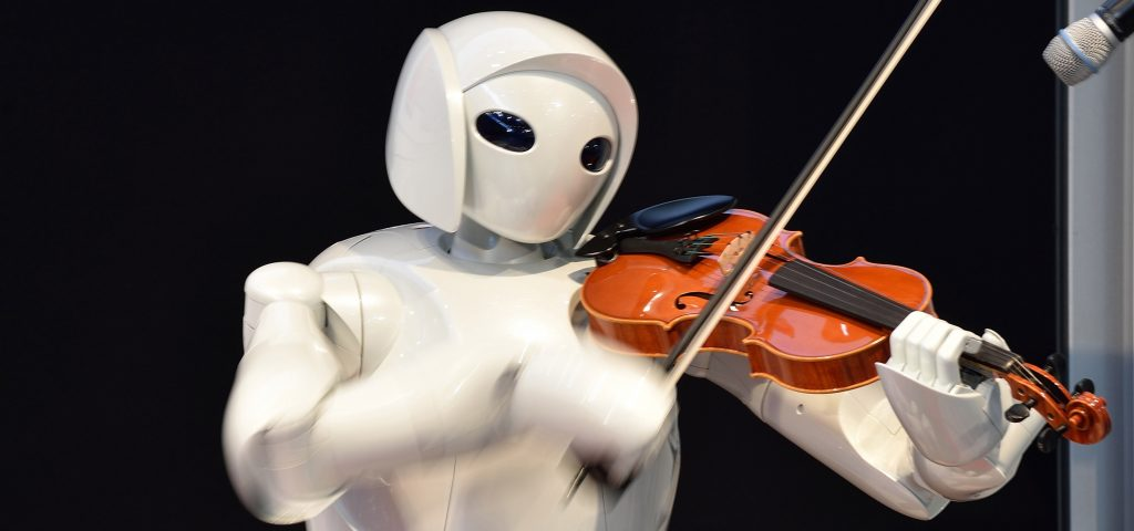 "A violin playing robot, a series of humanoid robots from Toyota Partner Robot, is displayed at a robot event for children in Tokyo on August 9, 2015. The robot event ""Wakudoki (Exciting) Robot Park"" runs to August 14 at Toyota Motor exhibition showroom Mega Web.  AFP PHOTO / KAZUHIRO NOGI        (Photo credit should read KAZUHIRO NOGI/AFP/Getty Images)"